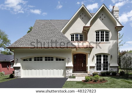 Front view of luxury home with arched entry - stock photo