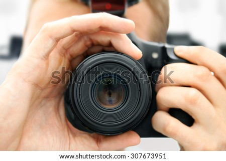 front view of man holding camera. closeup - stock photo