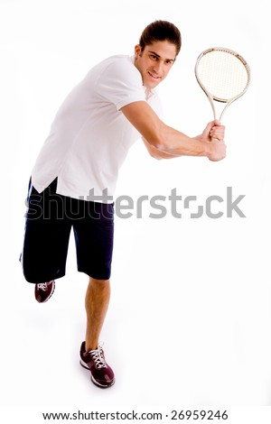 front view of man playing tennis on an isolated background - stock photo