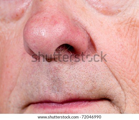 Front view of mature man's nose and upper lip with the mouth just visible - stock photo