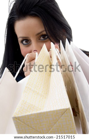 front view of model showing shopping bags on an isolated white background - stock photo