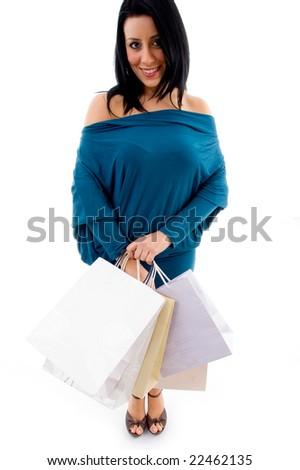 front view of model with shopping bags on an isolated white background - stock photo