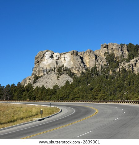 Front view of Mount Rushmore National Memorial from road. - stock photo