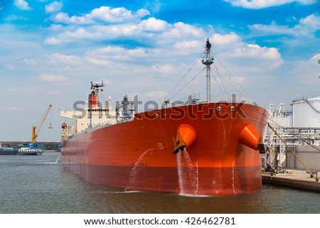 Front view of oil tanker moored near oil silo in Port of Antwerp, Belgium - stock photo