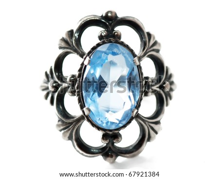 Front view of old silver ring with blue gem. - stock photo