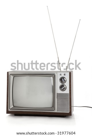 Front view of old television set with rabbit ears antennae on white background. - stock photo