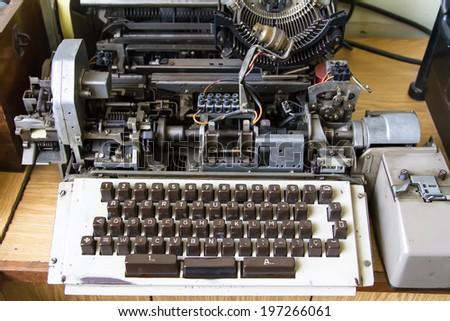 Front view of old typewriter machine. - stock photo