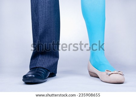 Front view of one male and one female leg as if belonging to one person. Transsexualism concept - stock photo