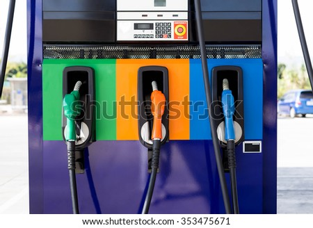 Front view of Petrol pump filling at gas stationg - stock photo