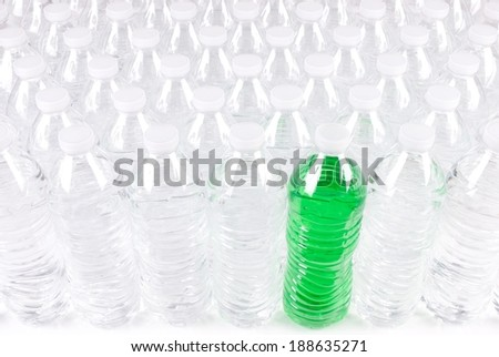 Front View of Plastic Water Bottles with One that has Green Colored Contents - stock photo