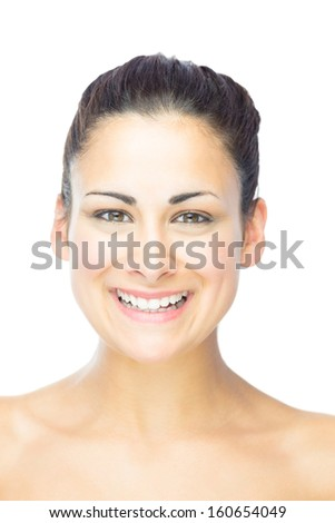 Front view of pretty young woman laughing at camera on white background - stock photo
