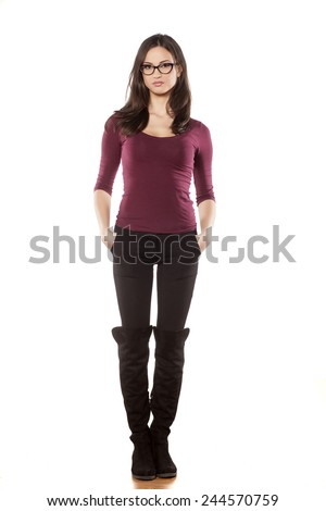 front view of pretty young woman, standing on white background - stock photo