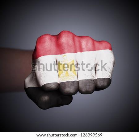 Front view of punching fist on gray background, flag of Egypt - stock photo