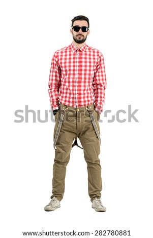 Front view of relaxed young hipster with hands in pockets. Full body length portrait isolated over white background.