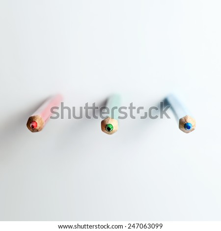 Front view of several colored pencils macro with shallow depth of field - stock photo
