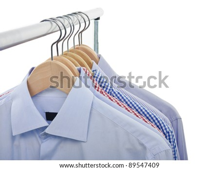 front view of shirts and hanger isolated on white background - stock photo