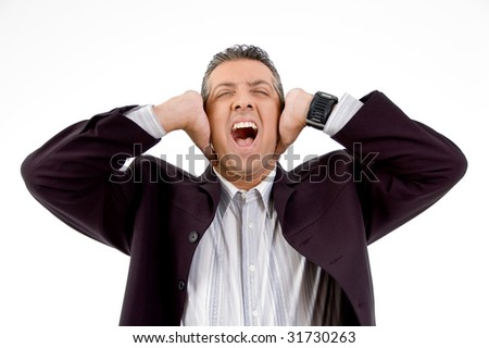 front view of shouting businessman putting hands on his ears with white background - stock photo
