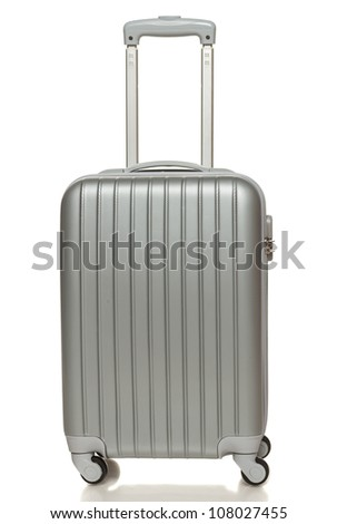Front view of silver travel suitcase standing over white background - stock photo