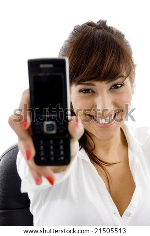 front view of smiling businesswoman showing her cell phone on an isolated white background - stock photo