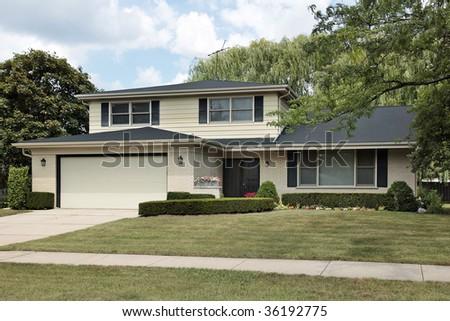 Front view split level suburban home stock photo 36192775 for Types of split level homes