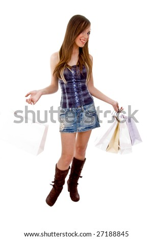 front view of standing model holding bags with white background - stock photo