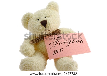 "Front view of teddy bear toy with ""Forgive me"" note, isolated on white background"