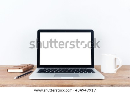 Front view of the laptop is on the work table concrete background clipping path inside - stock photo