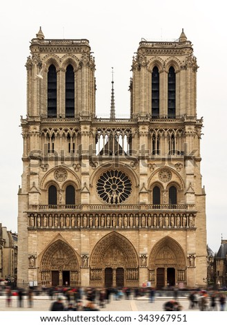 Front view of the Notre-Dame Cathedral in Paris with a moody sky