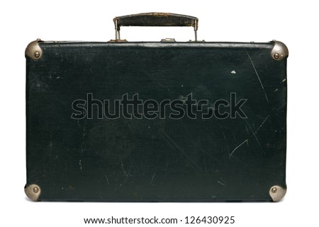 Front view of the old green suitcase with metal corners lying on the floor, isolated on white background - stock photo