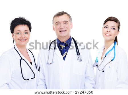 front view of three happy medical doctors standing together
