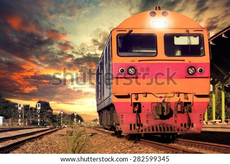 front view of trains on railways track parking in railroads platform station  - stock photo