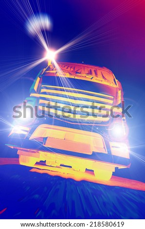 Front view of truck in move with headlights turned on dark background - stock photo