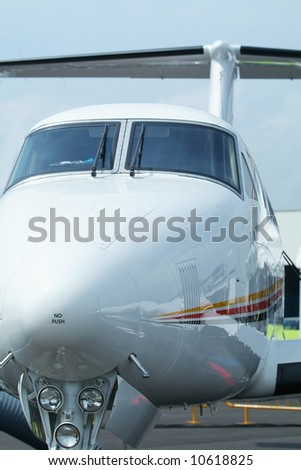 Front view of twin engine, turboprop, light business aircraft.