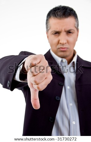 front view of unhappy boss showing thumb down with white background - stock photo