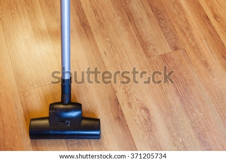 Front View Vacuuming Laminate Floor By Stock Photo 371205734