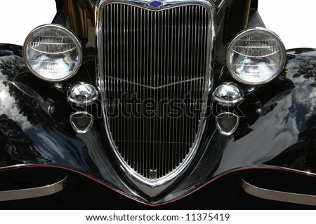 Front view of vintage black American hotrod, very tight crop. - stock photo
