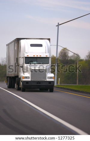 Front View of White Semi Truck on Road - stock photo