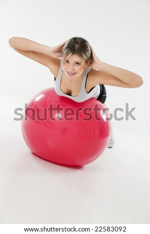 front view of woman exercising on fitness ball - stock photo
