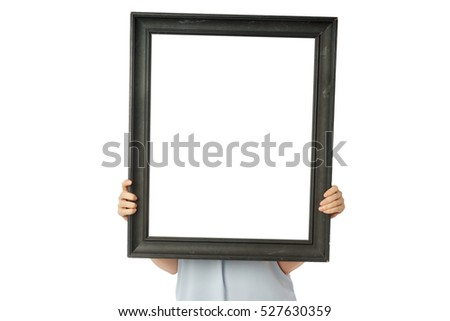 Front view of woman hands holding old vintage black empty frame, copy space