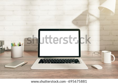 Front View Of Wooden Hipster Office Desk Top With Blank White Laptop  Display, Coffee Cup