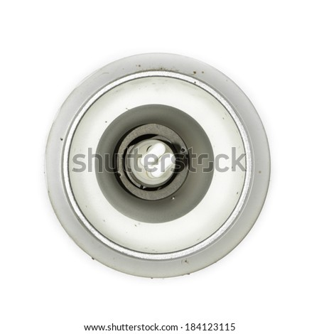 front view old energy saving light bulb on at silver plastic block isolated on white background