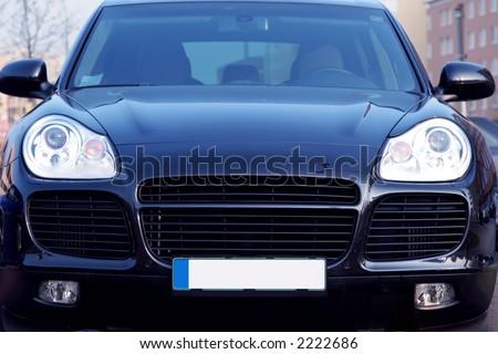 front view Porsche Cayenne - luxury German SUV - stock photo