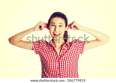 Front view portrait of a young joyful female caucasian teen making a face to the camera, on white. - stock photo