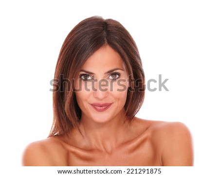 Front view portrait of adult latin woman showing her freshness with nude shoulders while smiling and looking at camera on isolated studio - stock photo