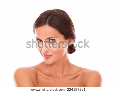 Front view portrait of sexy mature woman smiling at camera with nude shoulders on isolated studio - stock photo