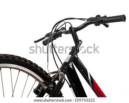 front wheel and handlebar of bicycle - stock photo