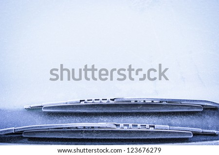 front window of a car in winter - space for text - stock photo