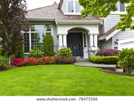 Front yard of modern home during late spring - stock photo