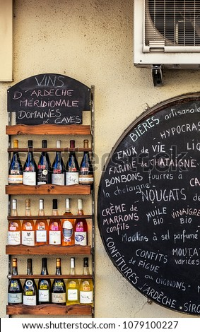 Frontage of an artisanal shop of local products, wines, beers, candies, Nougat, chestnut puree, jams, mustard, oil⦠etc Display unit of various wines. FRANCE - Montélimar on April 17th, 2018
