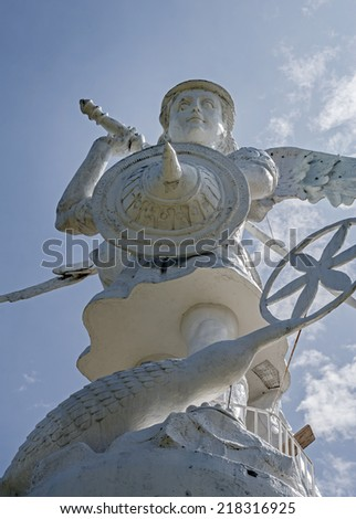 Frontal and low view of a statue of Saint Michael, Ibarra, Ecuador - stock photo